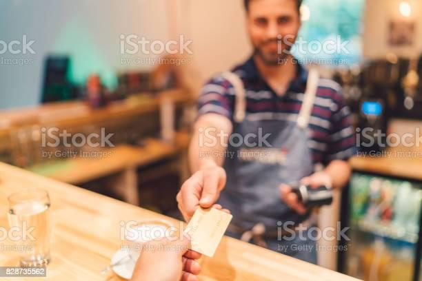 Payment with credit card in cafeteria picture id828735562?b=1&k=6&m=828735562&s=612x612&h=bqxwzatdssowtykhobzovrpltfalzg9ezfw7hluqfpa=