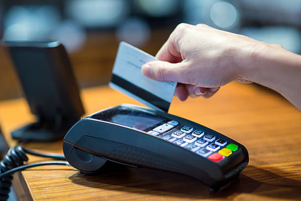 Payment with credit card Payment with credit card smart card stock pictures, royalty-free photos & images