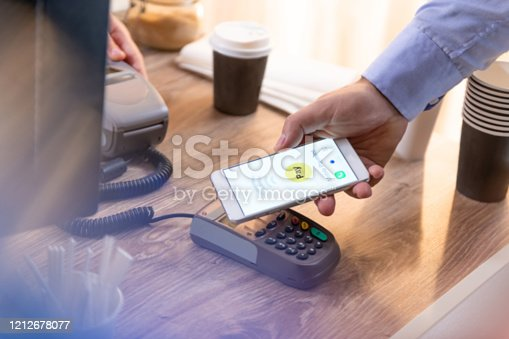 827843530 istock photo Payment with mobile 1212678077