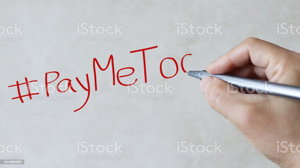 #PayMeToo text on paper background. stock photo