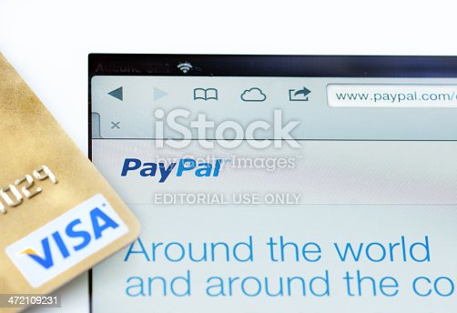 Quebec, Canada - December 23, 2013: Paypal and Visa online shoping, using an IPad, money transaction on the internet, or WWW.