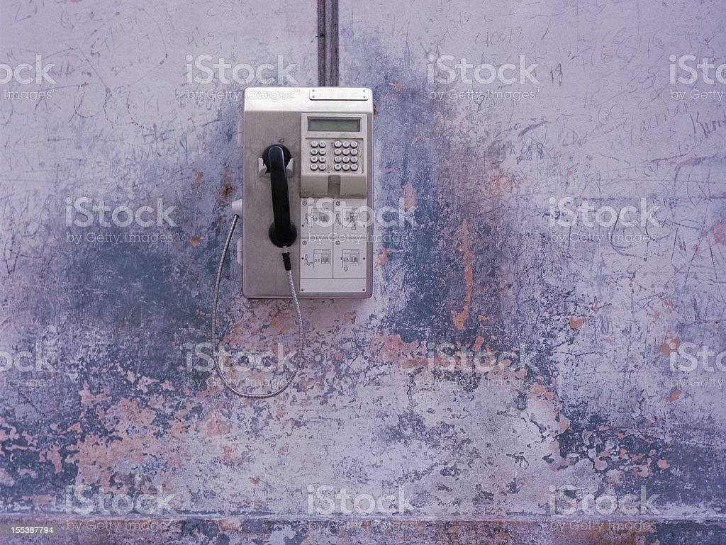 Payphone on Distressed Wall royalty-free stock photo