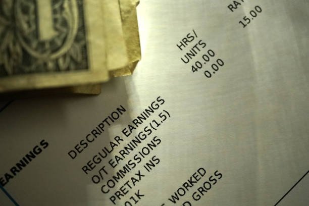 payroll stub close up shot of payroll stub wages stock pictures, royalty-free photos & images