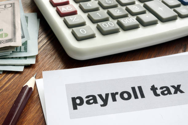 payroll tax concept. papers, calculator and money. - stipendio foto e immagini stock