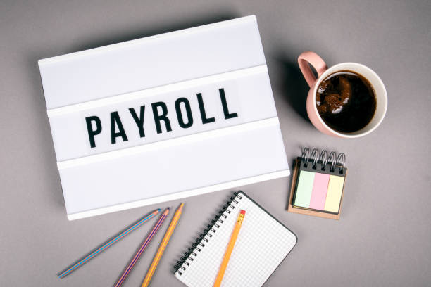 payroll. text in light box - stipendio foto e immagini stock