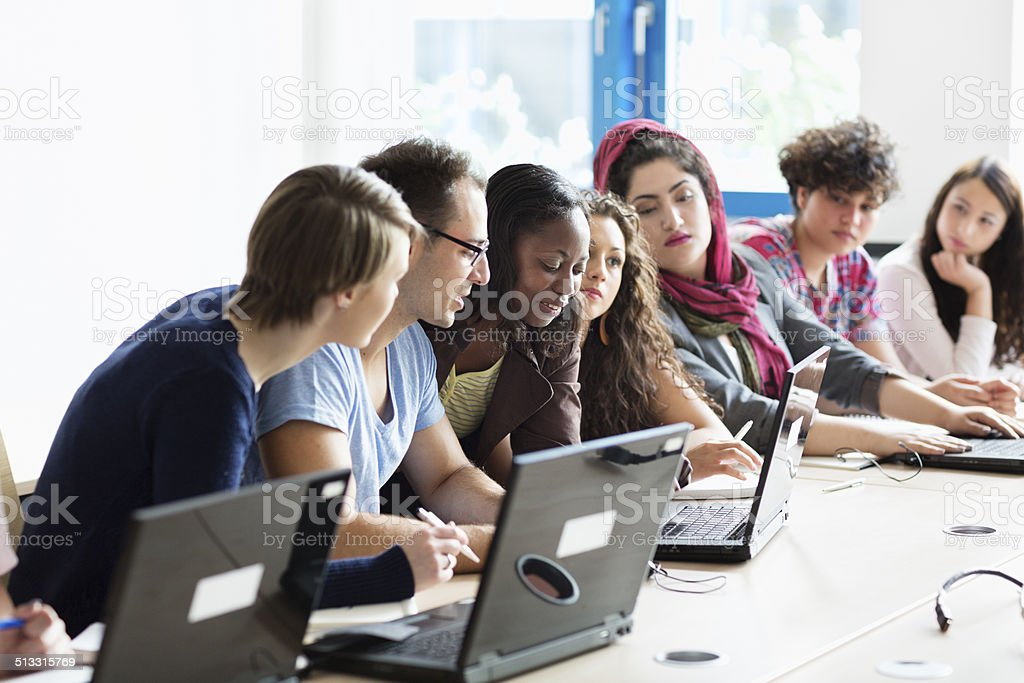 pc classroom college students with teacher stock photo