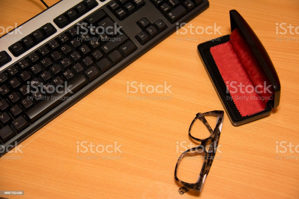 Pc Keyboard and eyeglasses, office work stock photo