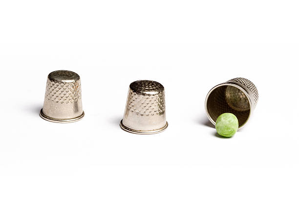 Pea and thimble trick A gambling con trick, also known as the shell game. A widely used metaphor for deceit,sleight of hand and confidence tricks in politics (a favorite saying for Australian politicians about the policies of the other team) and elsewhere shell game stock pictures, royalty-free photos & images