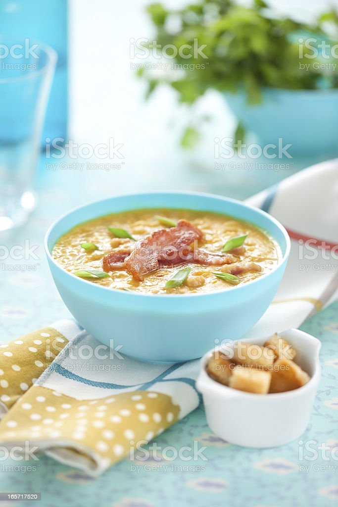 Pea soup with bacon and spring onion stock photo