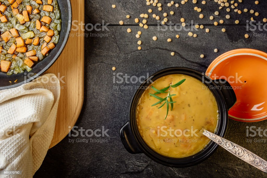 pea soup with carrots and onions top view stock photo
