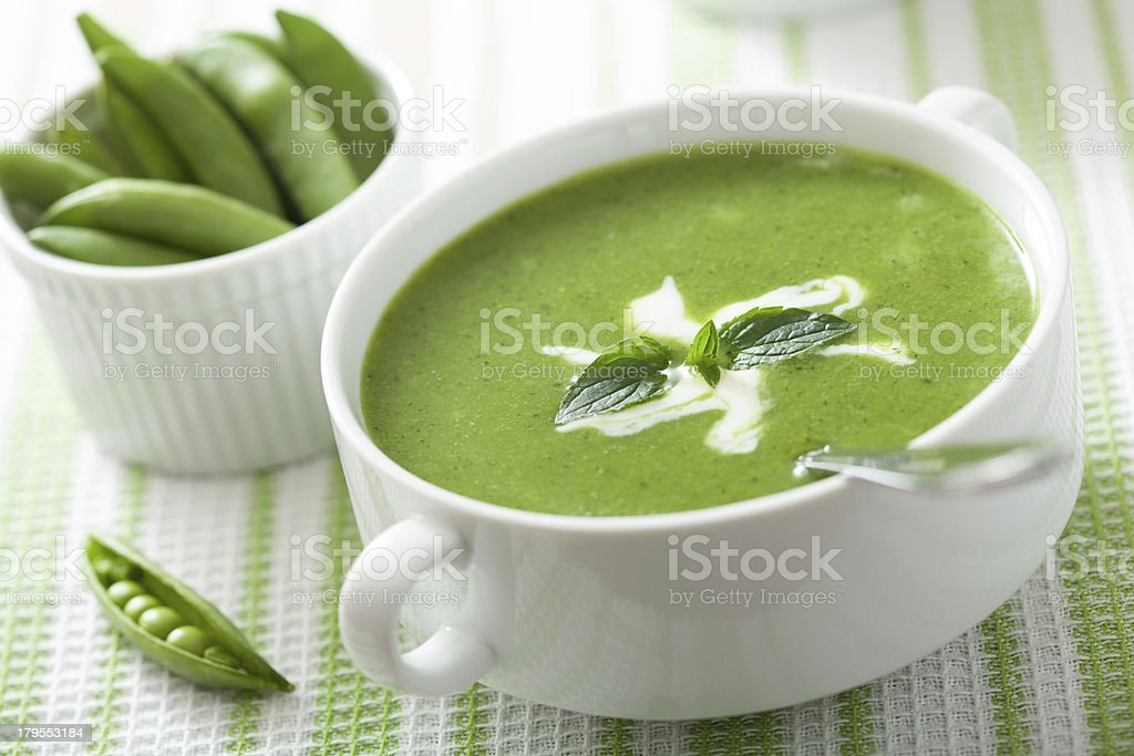 pea soup with mint stock photo