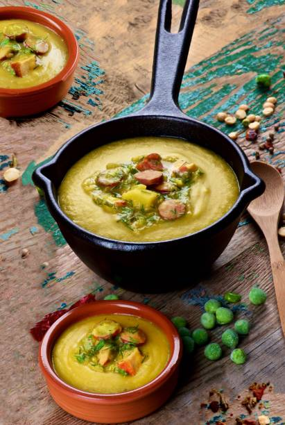 Pea Soup with Smoked Sausages stock photo