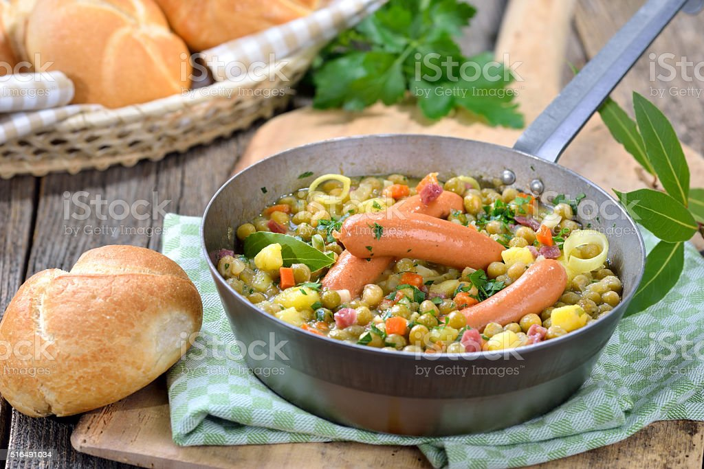 Pea stew with sausages stock photo