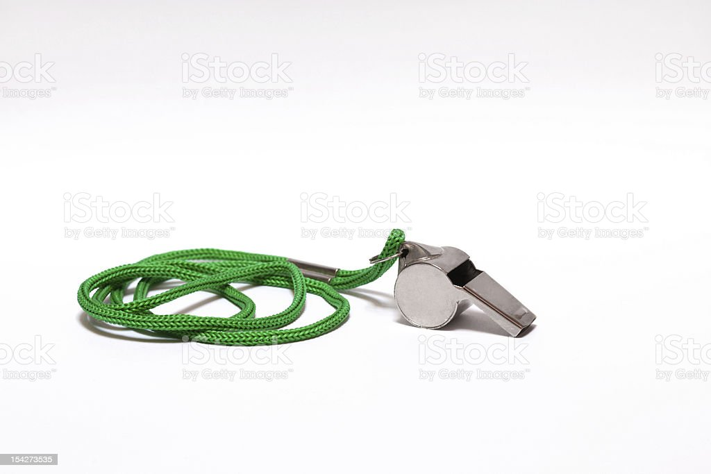 Pea whistle with a green string on white background stock photo