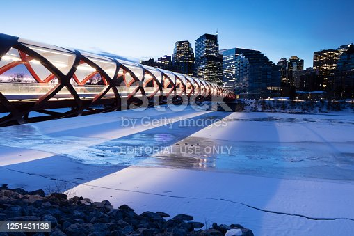 Image taken of the Peace Bridge stretching across the Bow River, early morning before sunrise. Low light, Image taken March/10/2020 on a tripod. peace bridge was designed by Spanish architect Santiago Calatrava, opened for public use on March/24/2012