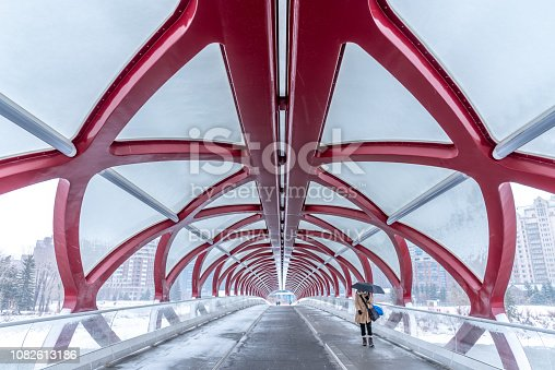Calgary, Alberta - December 1, 2018:  View of Calgary's Peace Bridge on a cold winter day. The Peace Bridge is an architectural attraction and a pedestrian bridge over the Bow River. The bridge, designed by Spanish architect Santiago Calatrava, opened for use on March 24, 2012.
