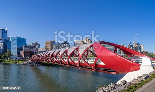 Calgary, Alberta - June 11, 2016: View of Calgary's Peace Bridge on a warm summer day.  The Peace Bridge is an architectural attraction and a pedestrian bridge over the Bow River. The bridge, designed by Spanish architect Santiago Calatrava, opened for use on March 24, 2012.