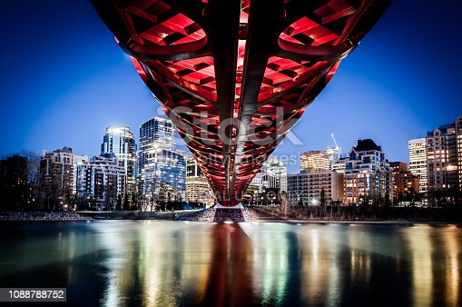 Calgary, Alberta - April 27, 2013: View of Calgary's Peace Bridge on a cold winter day. The Peace Bridge is an architectural attraction and a pedestrian bridge over the Bow River. The bridge, designed by Spanish architect Santiago Calatrava, opened for use on March 24, 2012.