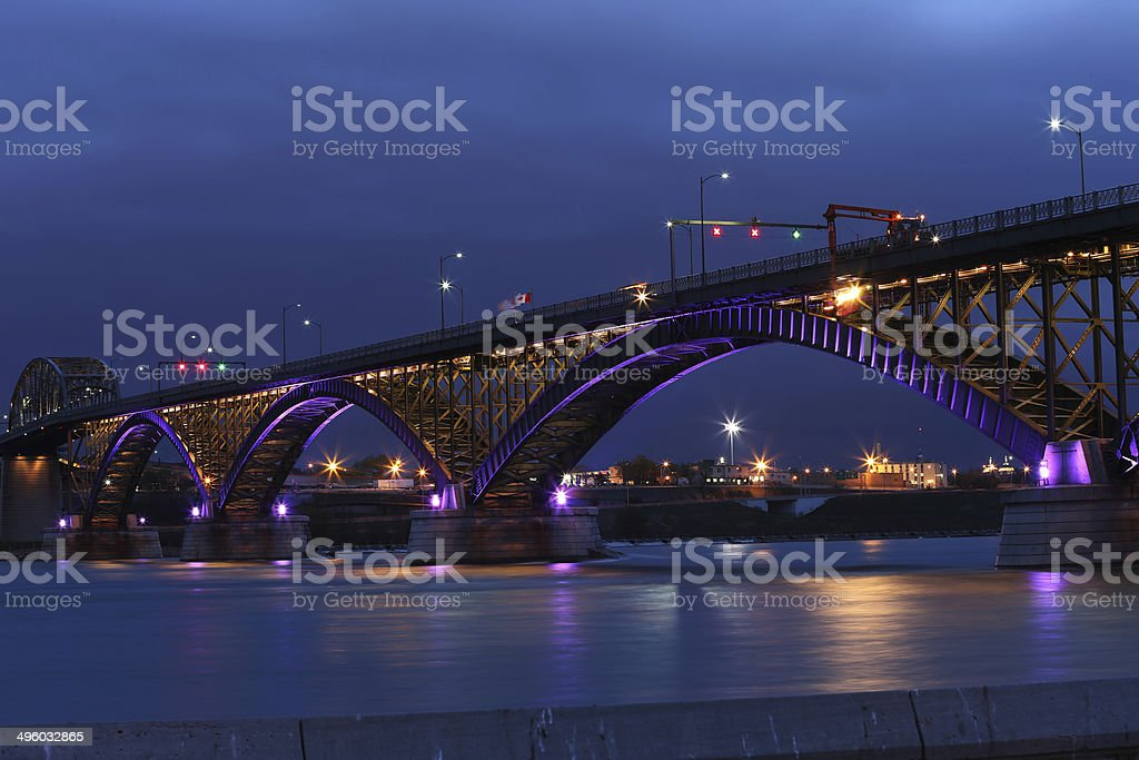 Peace Bridge with purple and gold lights stock photo