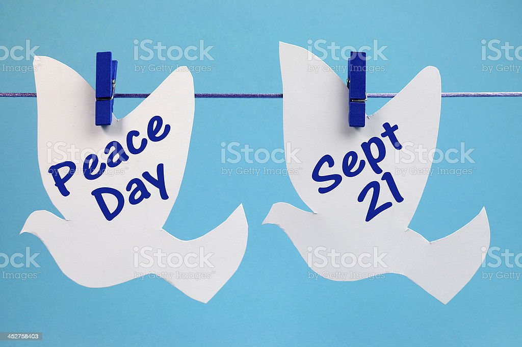 Peace Day message written across pegs on a line royalty-free stock photo