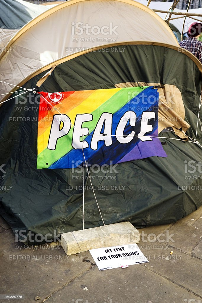 'Peace. My tent for your bonus' - Occupying London 2012 stock photo