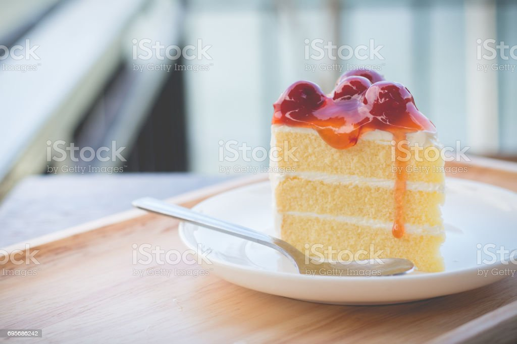 Peace of cherry cake served in afternoon time stock photo