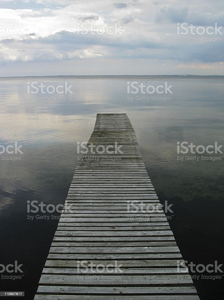 Peace - old wooden bridge, sea and sky in Denmark royalty-free stock photo