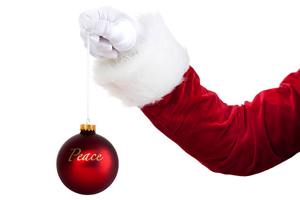 Peace On Earth Christmas Message Held In Santas Hand stock photo