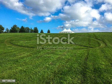 Peace sign mowed into the rolling green lawn at Bethel, New York and the site of the original Woodstock Music Festival.