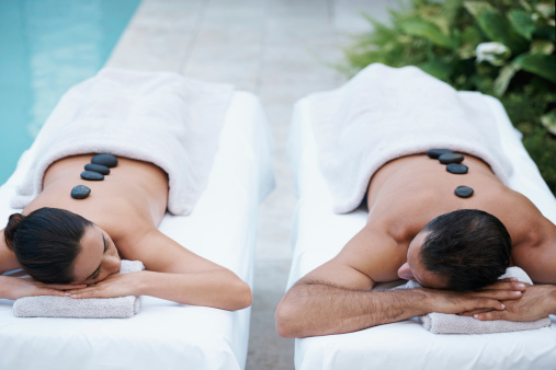 Cropped shot of a mature couple enjoying a hot stone treatment at a day spa