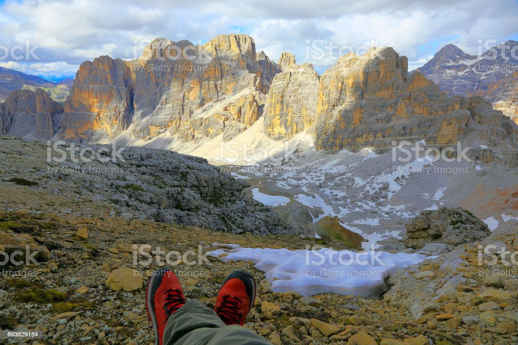Peace: Serene rest after trekking, Idyllic Lagazuoi summit panorama, Cinque Torri Dolomites, pinnacles mountain range, dramatic and majestic Italy tirol alps stock photo