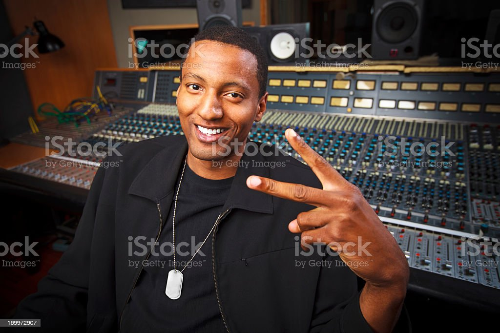 Peace Sign - African-American Recording Engineer in the Studio stock photo