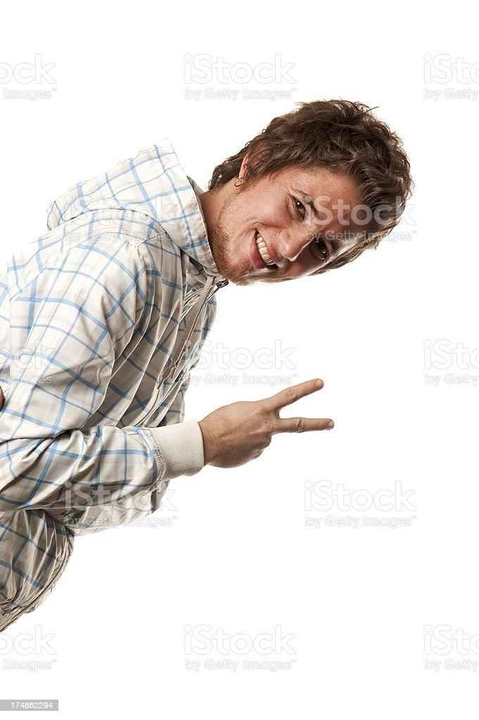 Peace sign and similing young man royalty-free stock photo