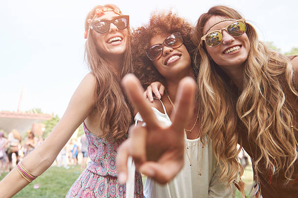Peace sign and three friends stock photo