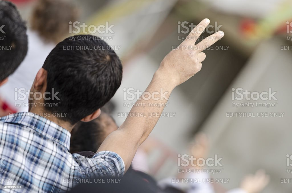 Peace sign during a demonstration stock photo