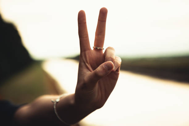 Peace Sign Hand Sign Woman Victory Hand Sign Outdoors stock photo