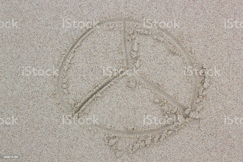 Peace sign on sand stock photo