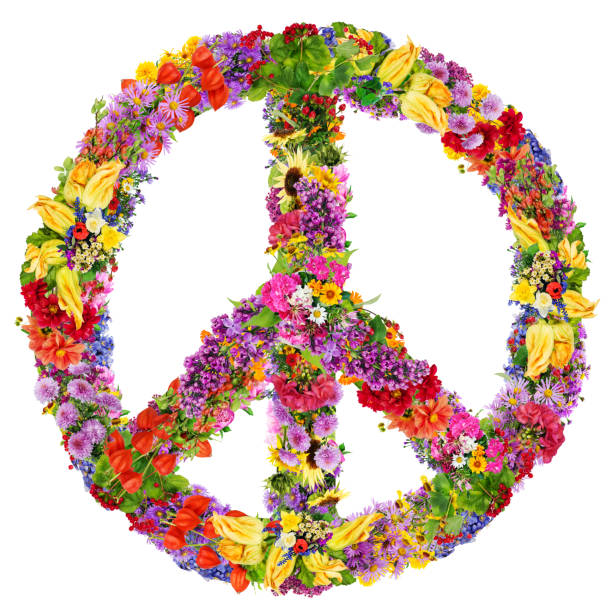 Peace symbol abstract collage made from fresh summer flowers. Isolated stock photo