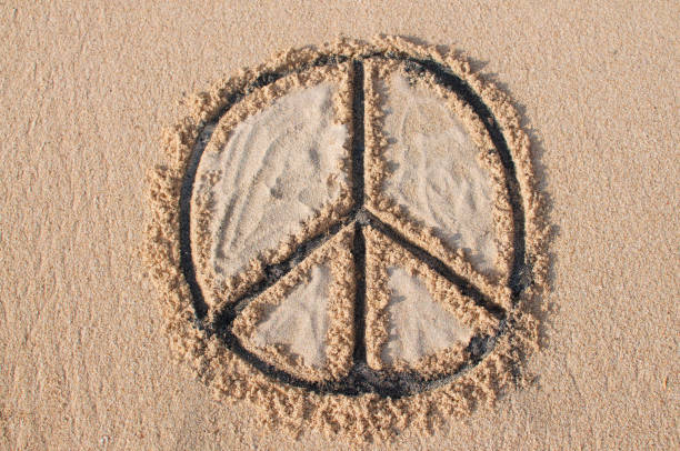 peace symbol drawn at the beach - symbols of peace stock pictures, royalty-free photos & images