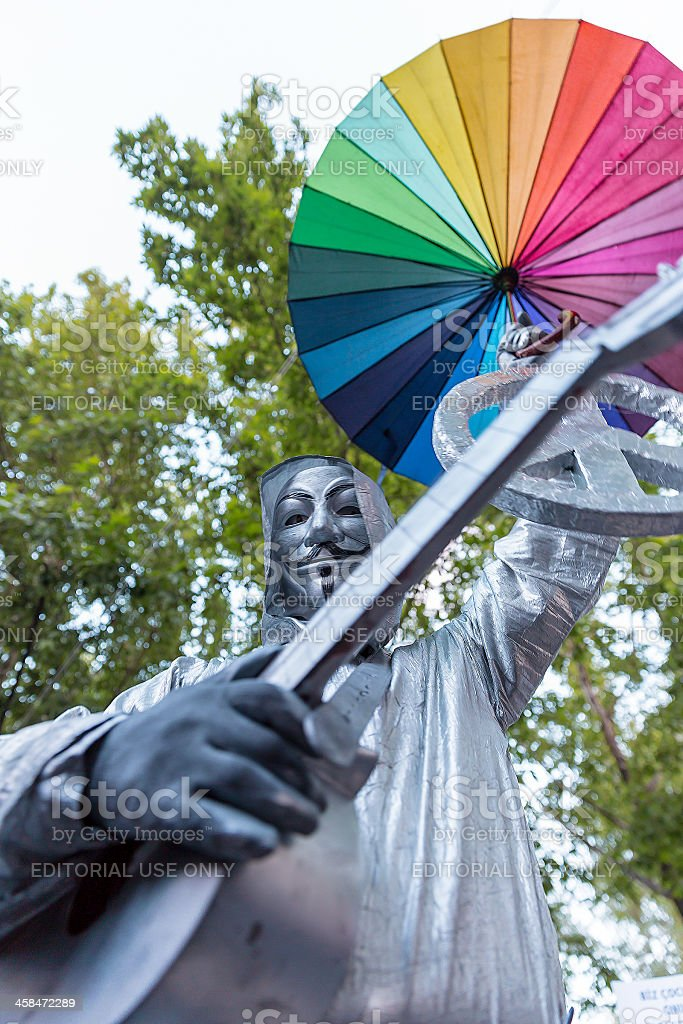 Peace under the all colors brotherhood's umbrella with V-Vendetta Mask stock photo