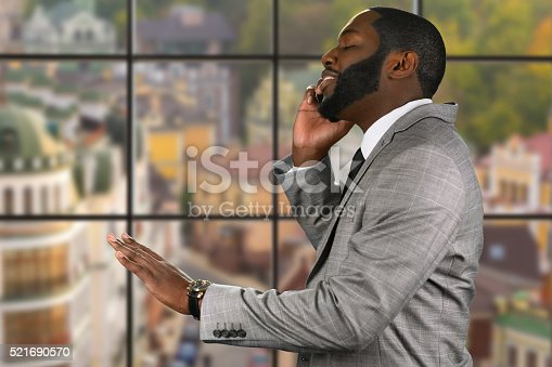 istock Peaceful afroamerican guy with cellphone. 521690570