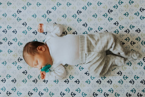 Peaceful baby sleeping in a crib Peaceful baby sleeping in a crib crib stock pictures, royalty-free photos & images