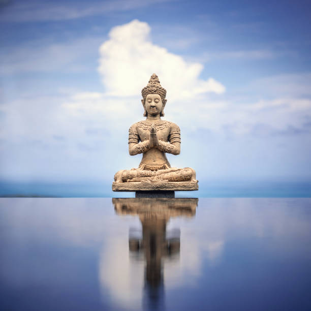 peaceful buddha statue - buddha stock photos and pictures
