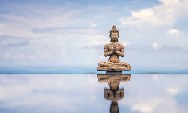peaceful buddha statue - hinduism stock photos and pictures