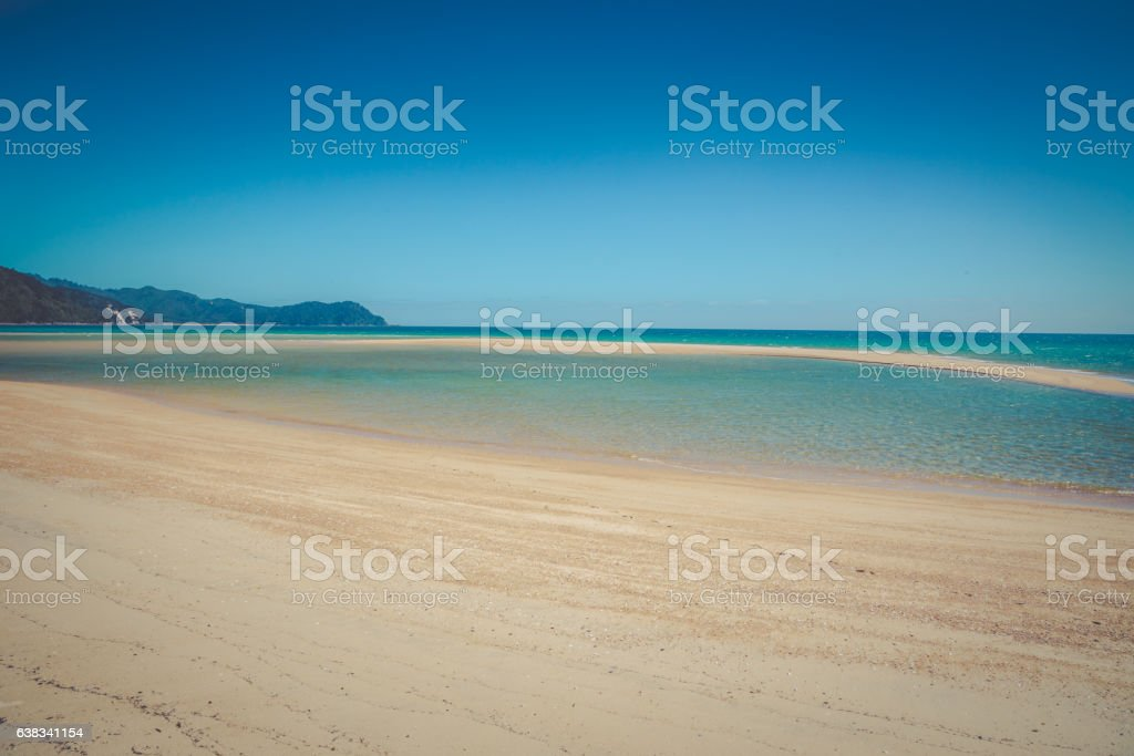 Peaceful dreamy ocean landscape with clear sky and white sand stock photo