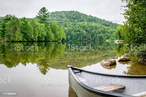 Photo of Peaceful fishing lake with mountain range