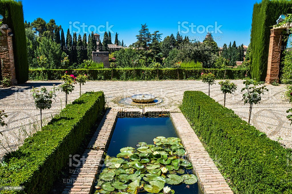 Peaceful garden with fountain - Granada, Spain stock photo