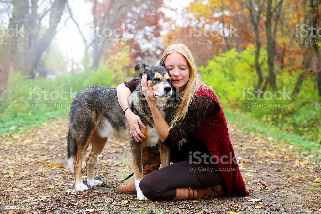 Peaceful Happy Woman Hugging German Shepherd Dog While - foto stock
