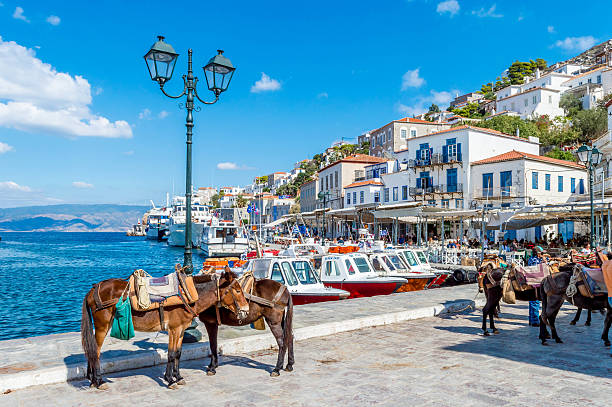 Peaceful island of Hydra Hydra, Greece - 03 October, 2015: Tourists are sitting in the restaurants of the port of Hydra. rymdraket stock pictures, royalty-free photos & images