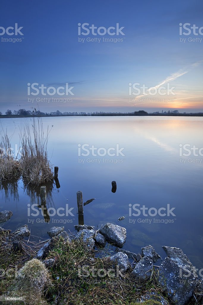 Peaceful lake at dawn in Muiden, The Netherlands stock photo